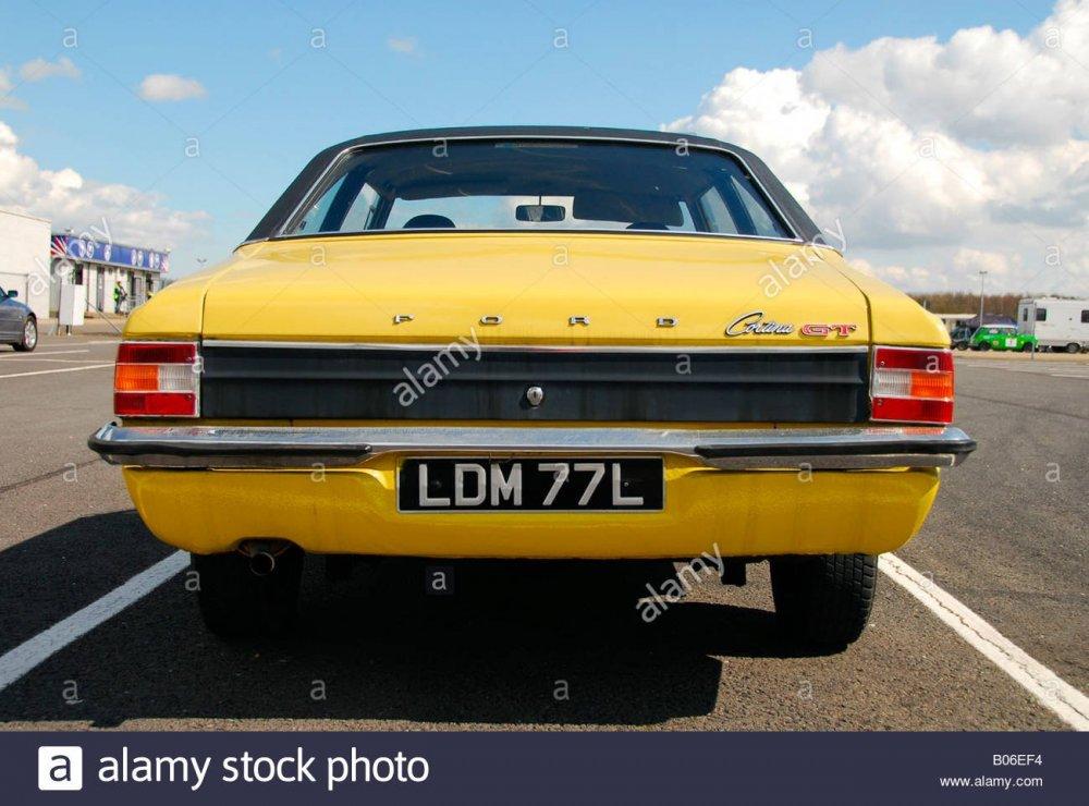 bright-yellow-ford-cortina-mk3-2000cc-gt-parked-in-the-paddock-at-B06EF4.thumb.jpg.0a349845c94ed81119fe95065a4748b6.jpg